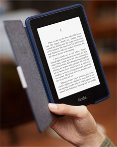 Hand holding Kindle reader