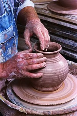 Potter throwing a vase